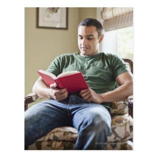 USA, Utah, Young man reading book Postcard