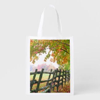 USA, Vermont. Fence under fall foliage. Reusable Grocery Bag