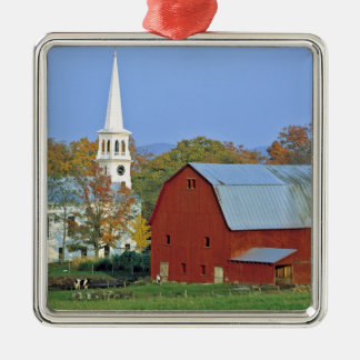USA, Vermont, Peacham. A red barn and white Christmas Ornament
