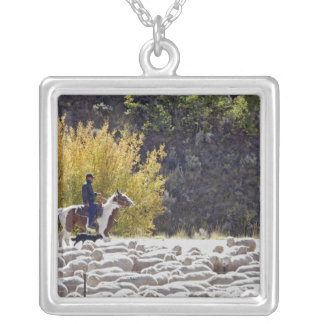 USA, Wyoming, Evanston. Cowboy herding sheep. Silver Plated Necklace