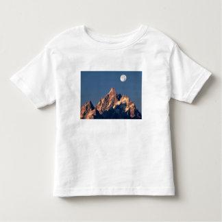 USA, Wyoming, Grand Teton NP. A full moon sets Toddler T-Shirt