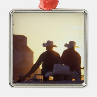 USA, Wyoming, Pine Bluffs. Two men shake Christmas Ornament