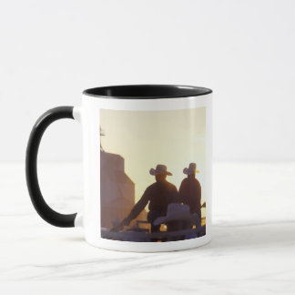 USA, Wyoming, Pine Bluffs. Two men shake Mug