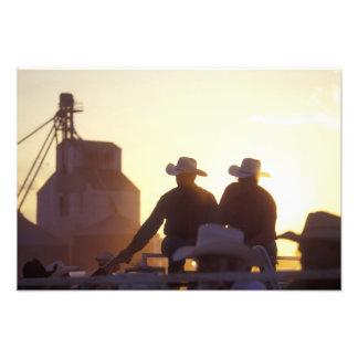USA, Wyoming, Pine Bluffs. Two men shake Photo Print