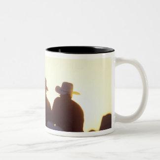 USA, Wyoming, Pine Bluffs. Two men shake Two-Tone Coffee Mug