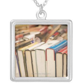 Used books at a rummage sale pendants