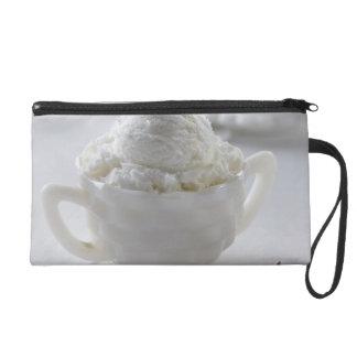 Vanilla ice cream in a white environment wristlet clutches