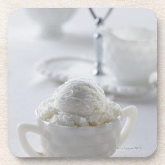 Vanilla ice cream in a white environment coaster