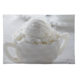 Vanilla ice cream in a white environment placemat