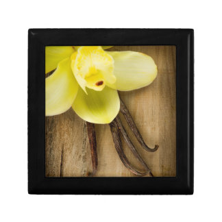 Vanilla Pods and Flower over Wooden Background Small Square Gift Box