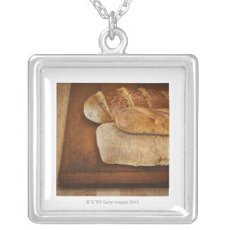 Variation of baked goods silver plated necklace