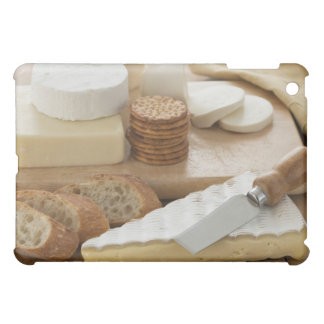 Various cheeses and bread on table iPad mini case