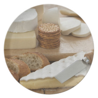 Various cheeses and bread on table plate