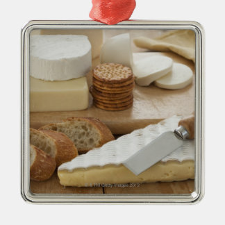 Various cheeses and bread on table Silver-Colored square decoration