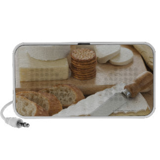 Various cheeses and bread on table notebook speakers