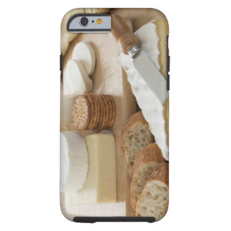 Various cheeses and bread on table tough iPhone 6 case