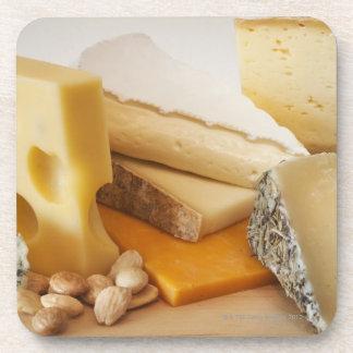 Various cheeses on chopping board coaster