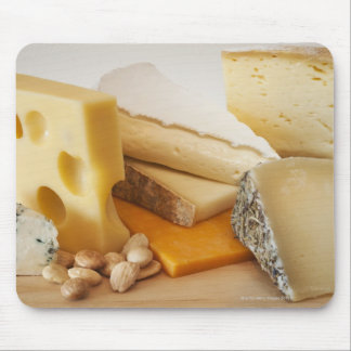 Various cheeses on chopping board mouse mat
