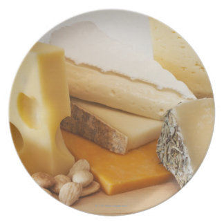 Various cheeses on chopping board plate