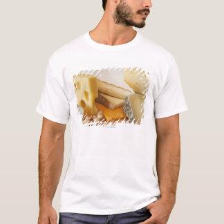 Various cheeses on chopping board T-Shirt