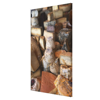 Various cheeses on market stall, full frame canvas print