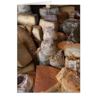 Various cheeses on market stall, full frame card