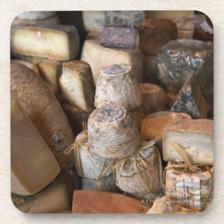 Various cheeses on market stall, full frame coaster