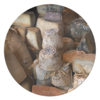 Various cheeses on market stall, full frame plate