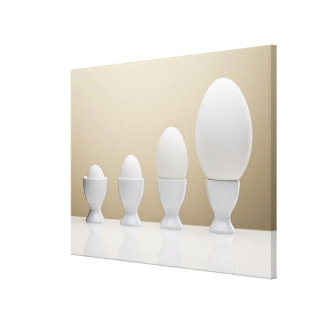 Various eggs in egg cups canvas print