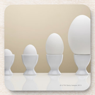 Various eggs in egg cups coaster