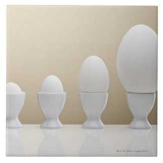 Various eggs in egg cups tile
