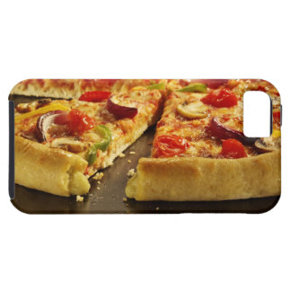 Vegetable pizza sliced on black pan on wood case for the iPhone 5
