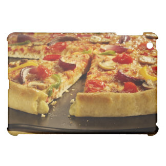 Vegetable pizza sliced on black pan on wood iPad mini covers