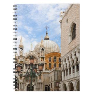 Venice, Veneto, Italy - Birds are perched on a Notebook
