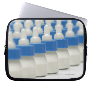 Very small feeding bottles in perspective, shot laptop sleeve