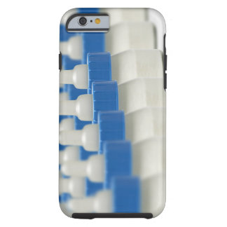 Very small feeding bottles in perspective, shot tough iPhone 6 case