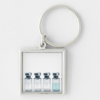 Vials containing medicine for injections. This Key Ring