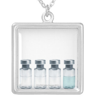 Vials containing medicine for injections. This Silver Plated Necklace