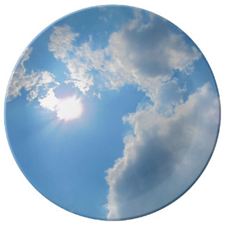 Vibrant blue sky with sun and clouds photo plate