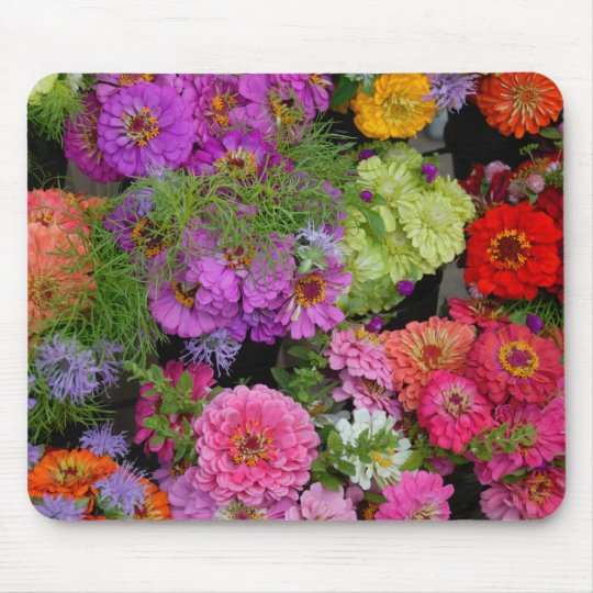 Vibrant coloured daisies mouse mat