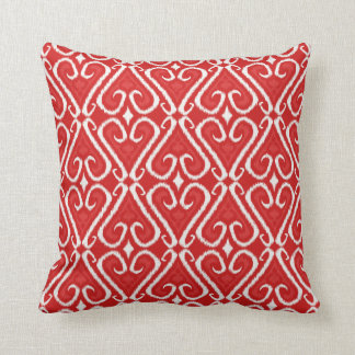 Vibrant ikat pattern in red and gold cushion