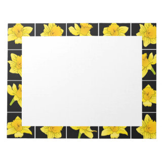 Vibrant Yellow Daffodil Flowers on Black Notepad