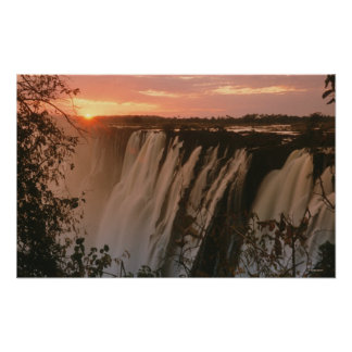 Victoria Falls with sun on horizon, Victoria Poster