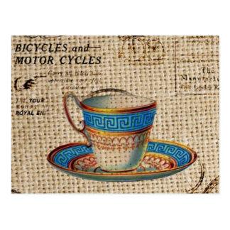 victorian teacup on burlap background design post card