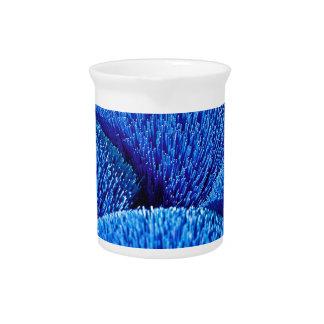 Vietnamese joss sticks in blue drink pitchers