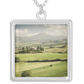 View across Tuscan landscape to farmhouse and 2 Silver Plated Necklace