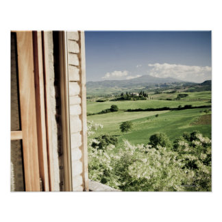 View across Tuscan landscape to farmhouse and Poster