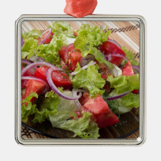 View angle on a fragment of vegetarian salad Silver-Colored square decoration