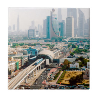 View of city metro line and skyscrapers small square tile