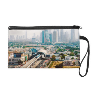 View of city metro line and skyscrapers wristlet purse